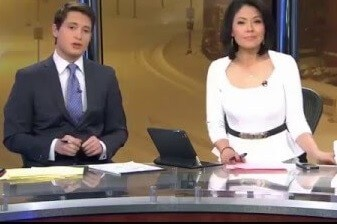 News reporters behind desk